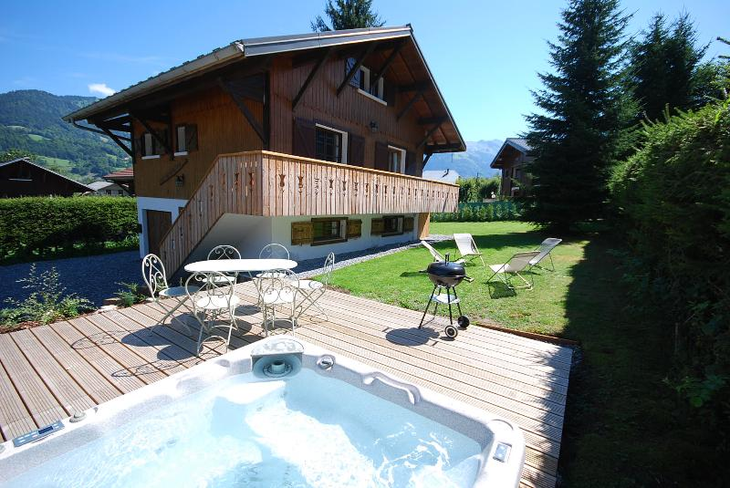 Garden in summer with hot tub