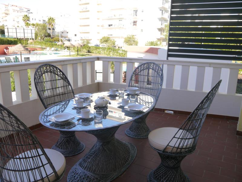 Large Oval Glass table and lovely  chairs for enjoyable alfresco dining /overlooks the pool