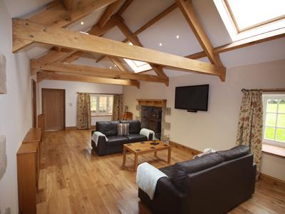 Lovely large living room with exposed beams and real fire