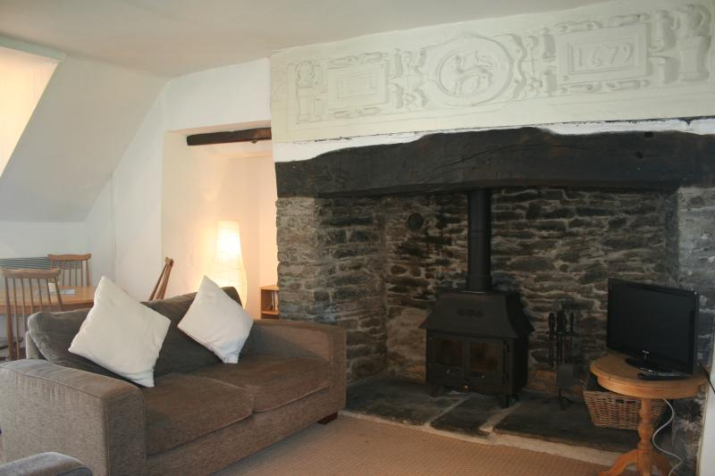 Lounge with new log fire & Grade II Listed Plaque above the Inglenook Fireplace