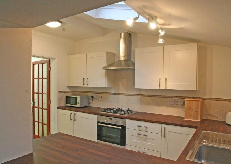 Excellent fully equipped kitchen and separate laundry room. Serving counter to dining table