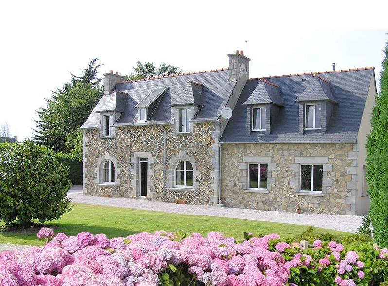The breton style villa on the pink granit coast in Brittany.