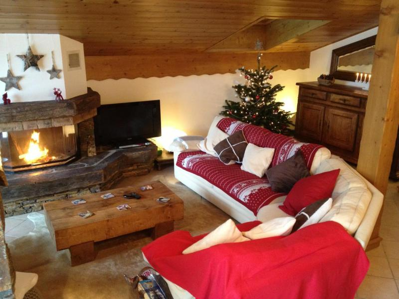 Lovely spacious living area with a fire place and TV