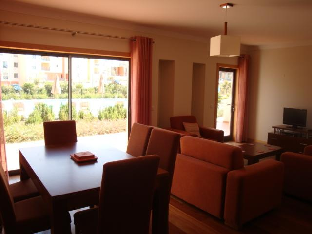 Comfortable lounge and dining area. Doors to pool!