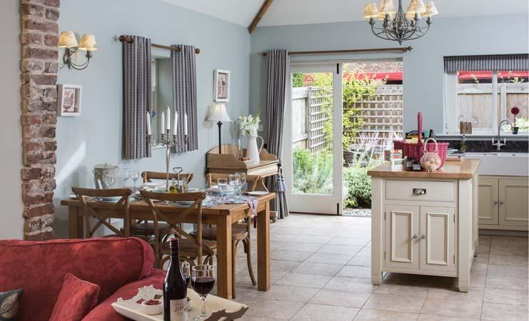 The Dovecote kitchen / dining with island, granite worktops and private patio
