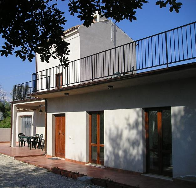 Sunny villa with patio and large roof terrace offering panoramic views of quiet countryside