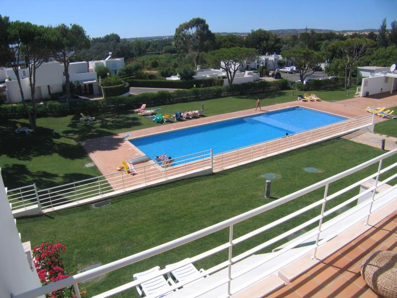 View from 1st floor terrace, Massive Pool with amenities block and sun loungers