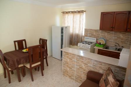 Equipped kitchen, kitchenware and seating area