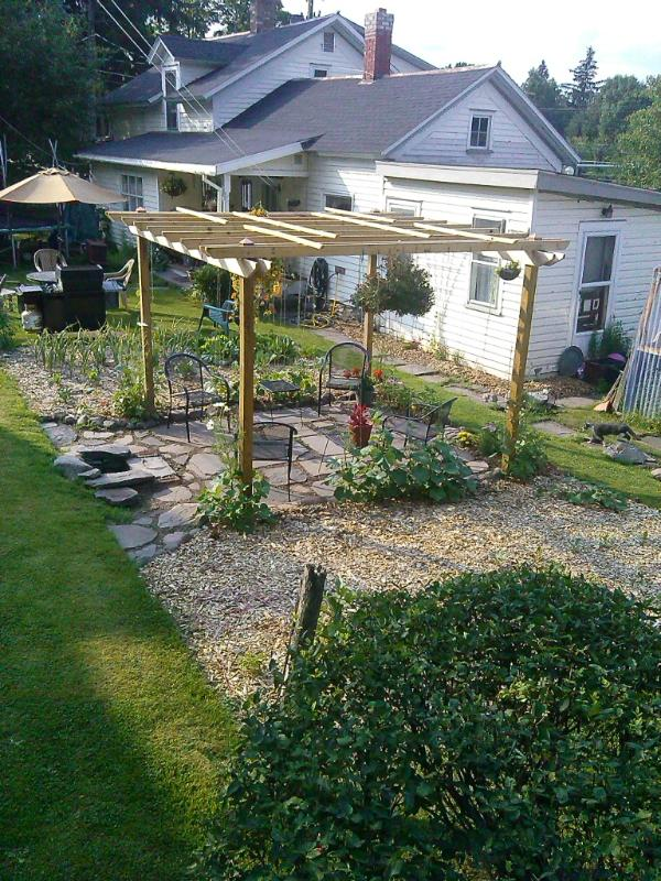 Newly Installed Pergola with fire pit...Enjoy a beautiful sunny day with outdoor seating in the garden area...and warm by the fire on a cool mountain evening.