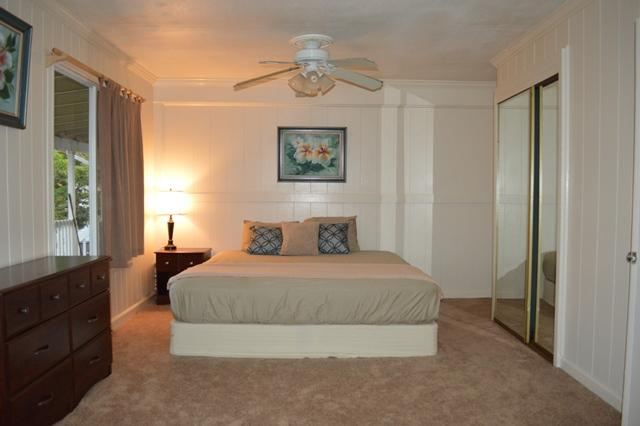 The master bdrm is very spacious & breezy. There are 2 closets w/shelves & lg. mirror doors on each.