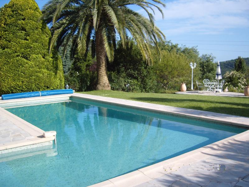 Large 'L' shaped pool in beautiful gardens