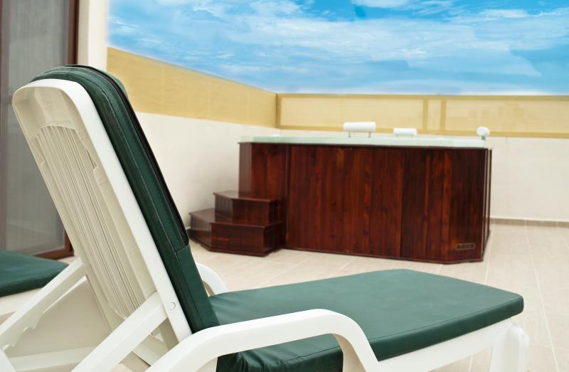 Sun deck Area with private Hot Tub