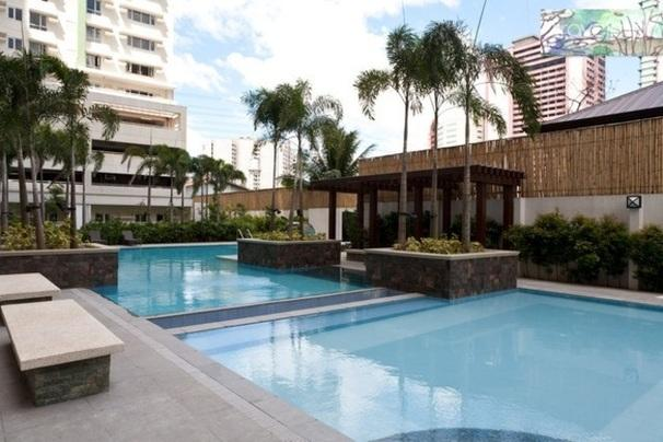 DE-STRESS by enjoying a dip in the pool with the property's tropic landscaping after a full-on