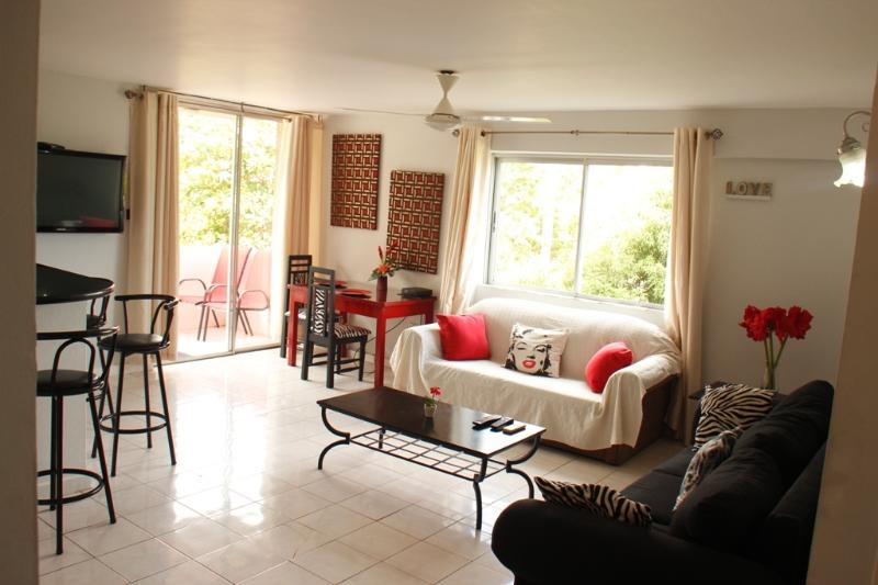 Spacious open plan lounge...with flat screen television.adn free WIFI ..leads onto balcony