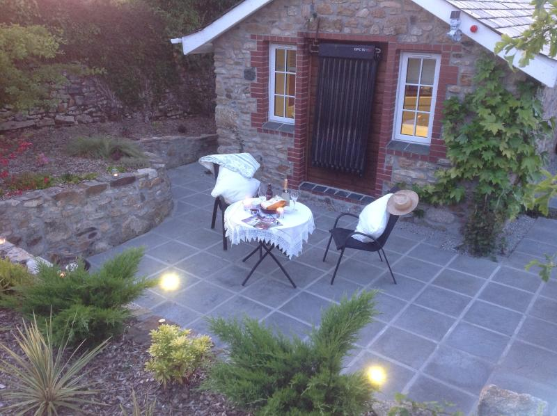 Dine out under the stars on your private patio with in-floor lighting!