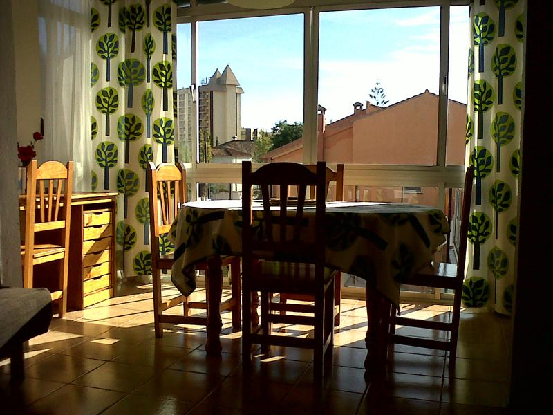 Dining area on enclosed balcony , south west facing.
