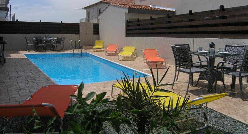 Large rear terrace & garden with sun soaked pool.