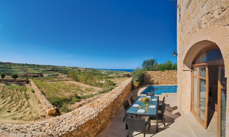 Pool and deck area with amazing country and distant sea views