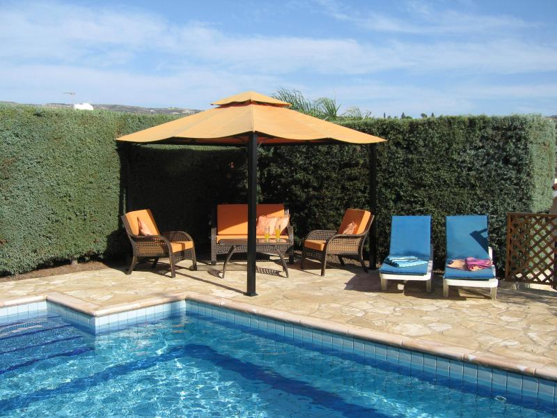 A delightful corner for shade or to sunbathe in the secluded upper terrace by the pool