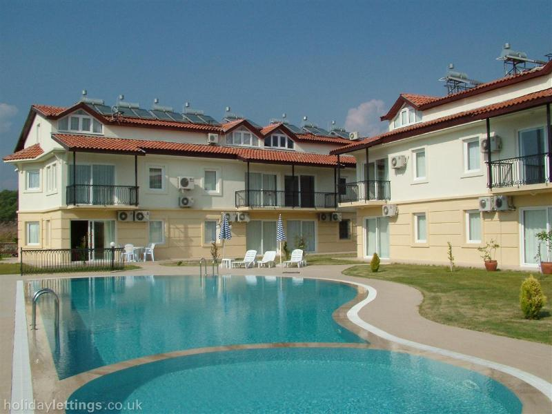 Relax by the pool on this small complex of 14 Apartments