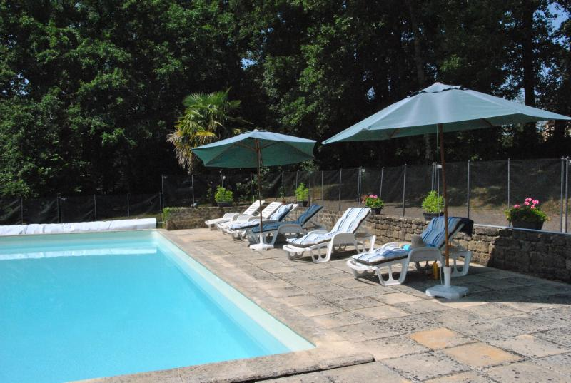 Cool off in the pool or soak up the sun on loungers with parasols for when you need some shade!