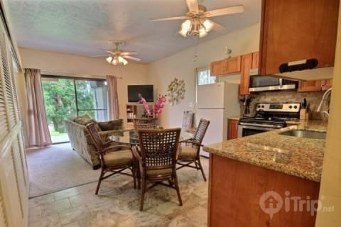Spacious living area and remodeled kitchen with granite counter tops