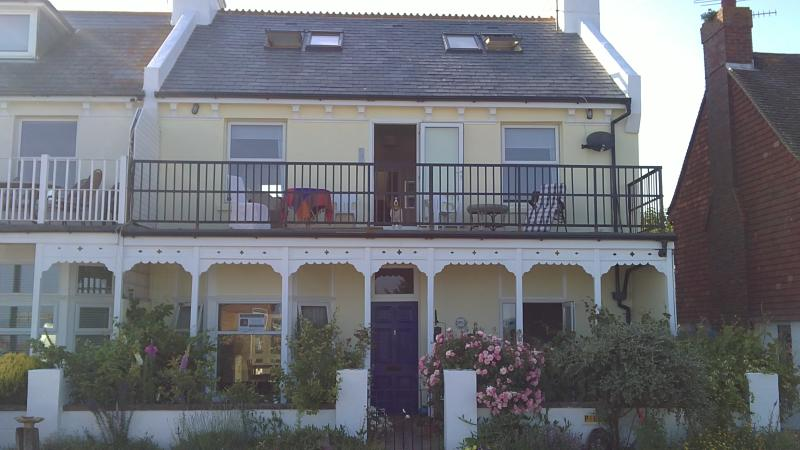 The apartment is on the ground floor of this charming Victorian house directly facing the sea