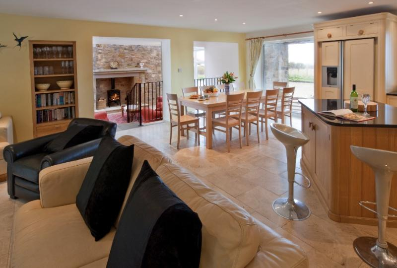 Huge open plan living/dining/kitchen area, french doors to rear balcony and steps down to orangery.