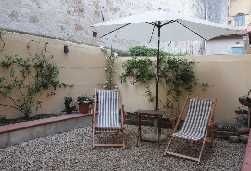 The beautiful walled garden is a quiet, cool spot for an al fresco aperitivo or meal