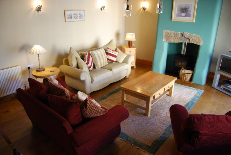 Newly decorated open plan living area. Light and cool in Summer. Cosy in Winter with log fires.