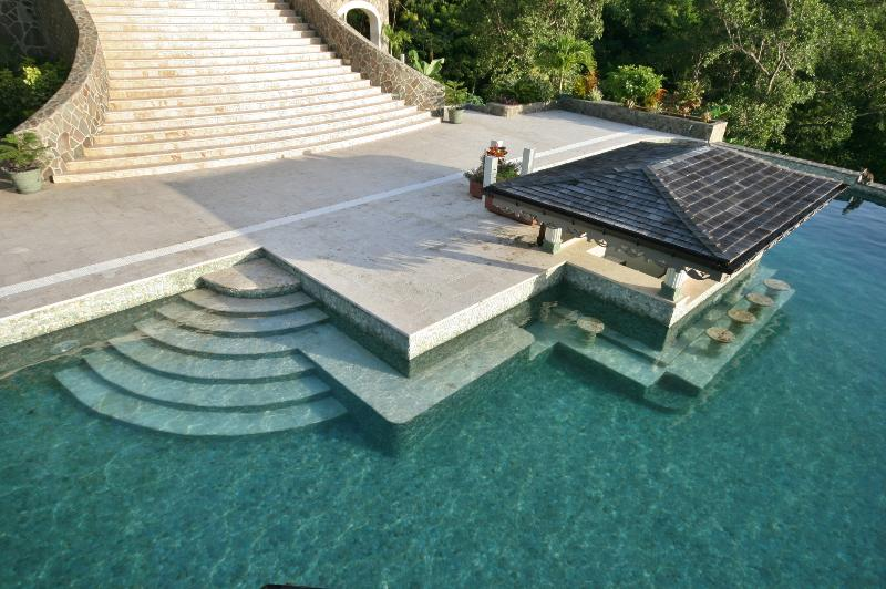 The main entrance to the Poolhouse is  through the sunken pool bar.