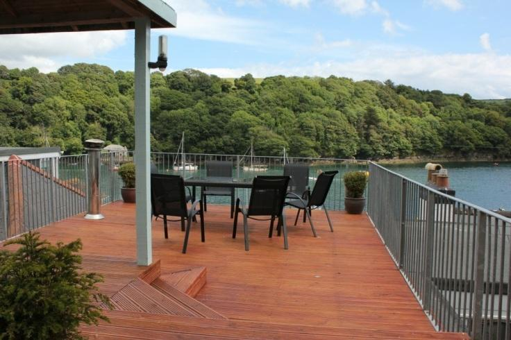 Decking area with view across Fowey river to Hall walk