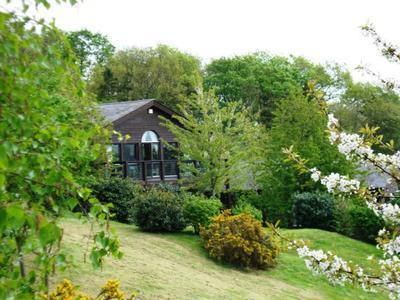 Lodge settings on hillside overlooking golf course and Grantham