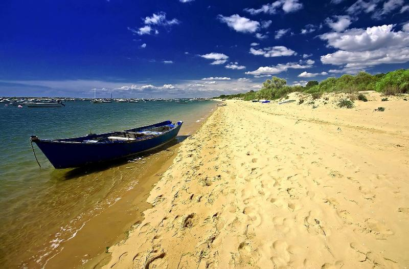 A BOAT BETWEEN 2 BEACHES, AT THE RIVERMOUTH OF THE PIEDRAS RIVER