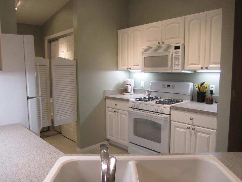 Beautiful kitchen with soft Florida colors and under cabinet lighting!