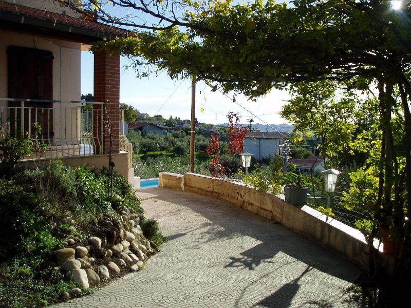 Main terrace of the house with the pool in the back