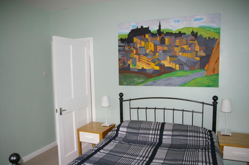 Bedroom showing double wrought iron bed