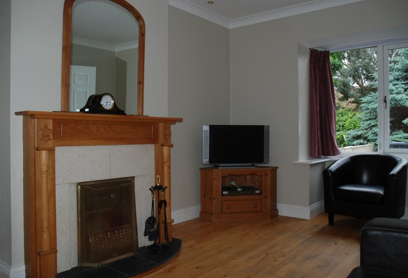 Living room, with open fire, cable tv. House also has gas central heating.