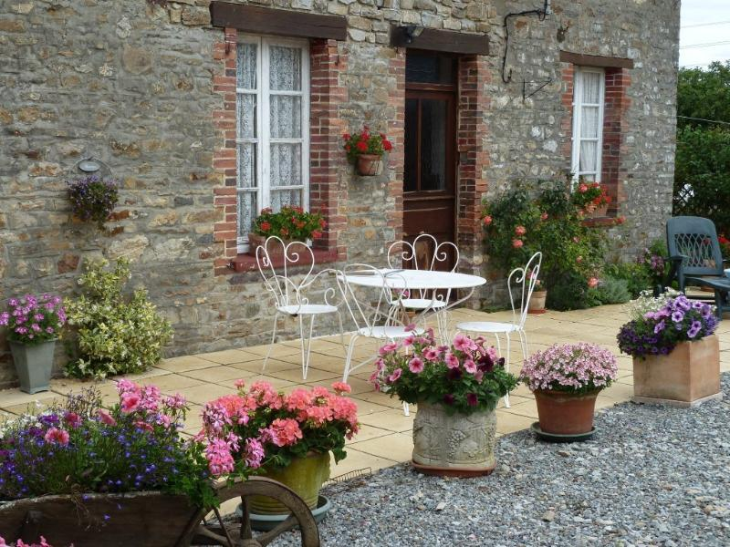 the courtyard is full of lovely color and the garden an oasis of green and flowers