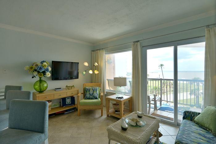 Living Room with flat screen tv and view of gulf