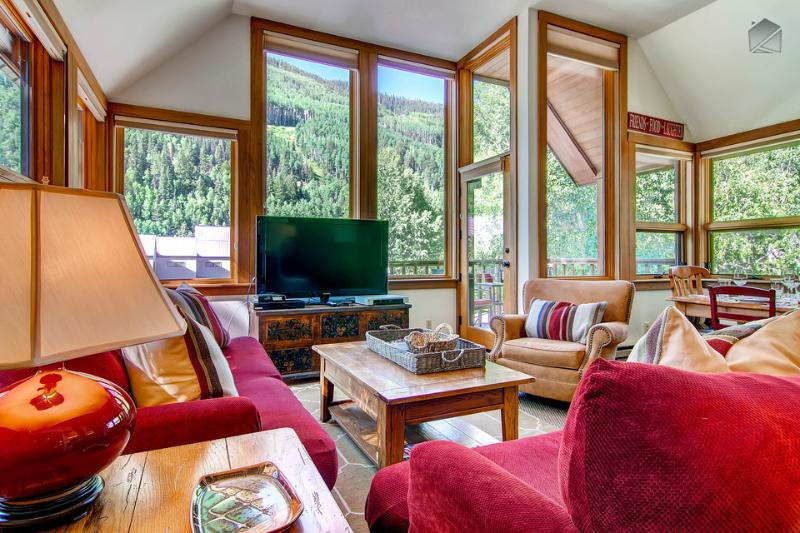 The windows all around this huge living area provide lots of natural light and some amazing views.