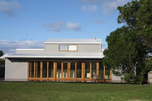 6 Robertson St, with kitchen / living area opening out on to a huge deck and back yard.