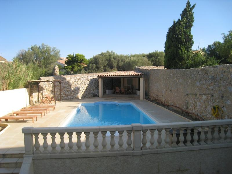 Swimming Pool and Pool House showing Loungers