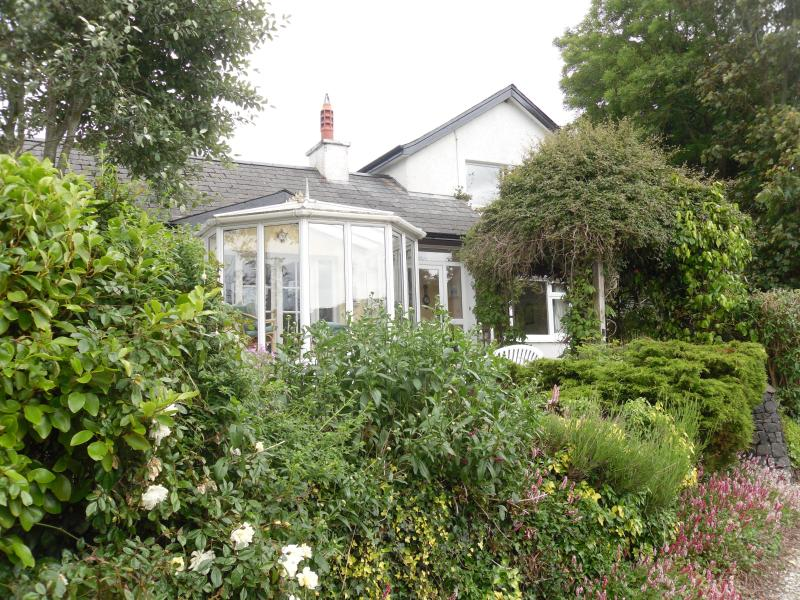 Braeside Lodge with it's beautiful front garden. The property also has a private back garden.
