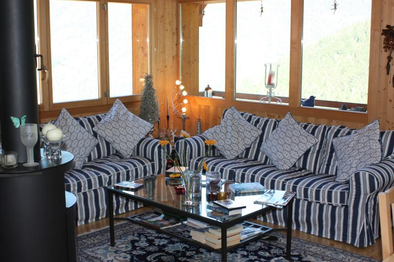 Comfortable sofas for 6 and super  panoramic views across the village and far distance