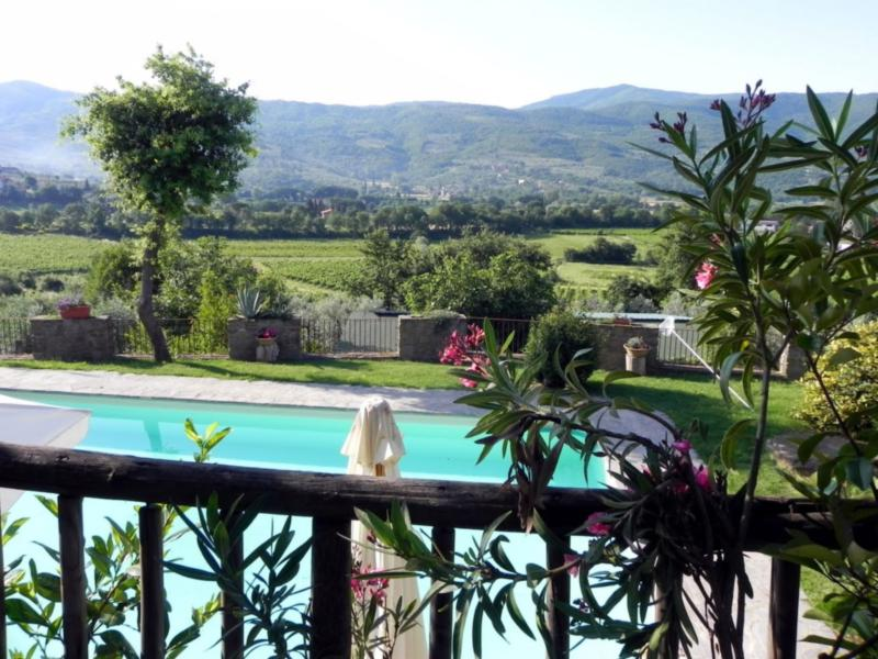 Fabulous view of pool and valley from terrace.  Relax, its your home in Tuscany!
