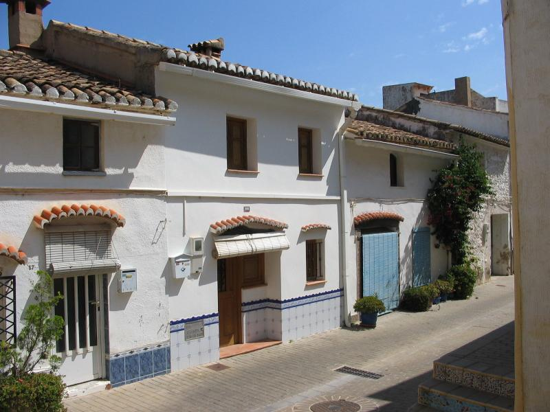La Casita - front opens onto a charming street in the oldest part of the village