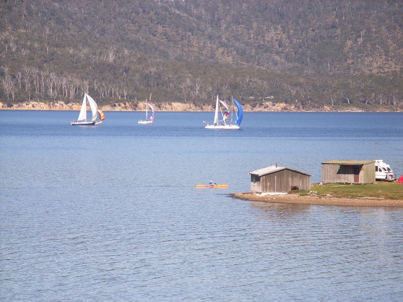 Yachts on the Channel looking out from the deck with Bruny Island in the back ground