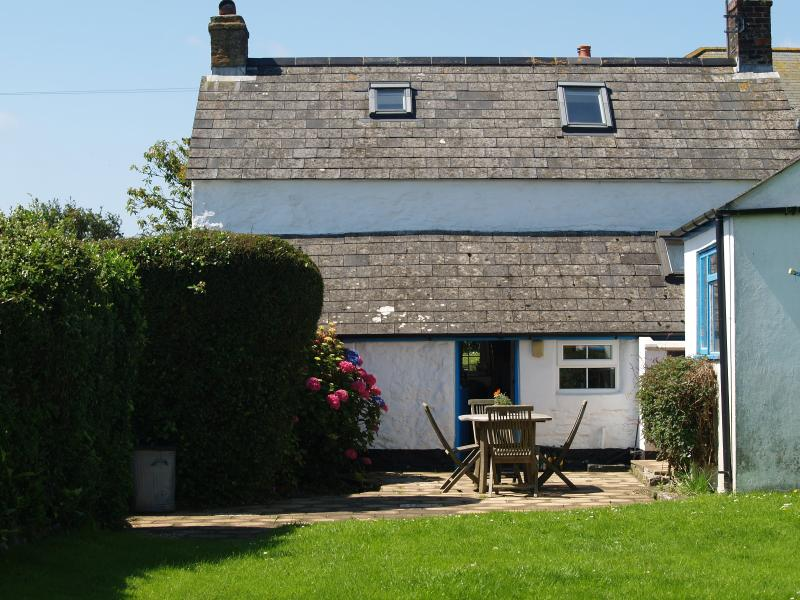 Mellangoose cottage, terrace and enclosed back garden with views over the fields
