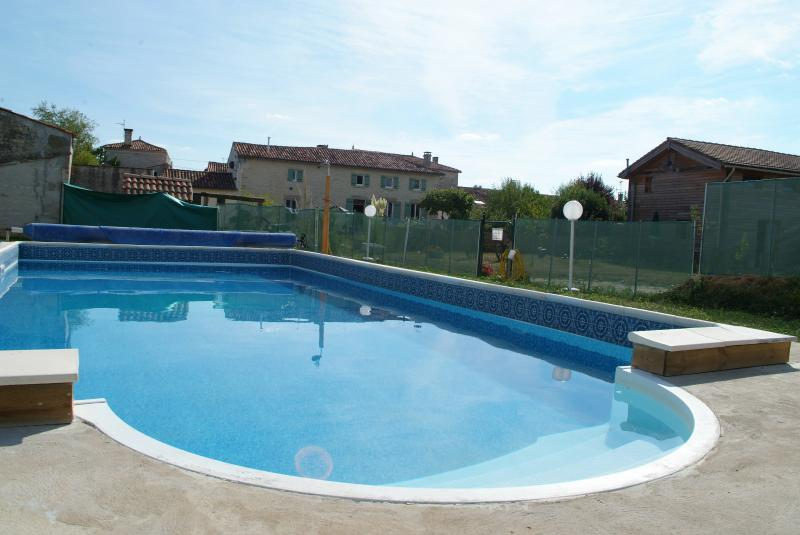 Heated swimming pool with child safety fence and gates